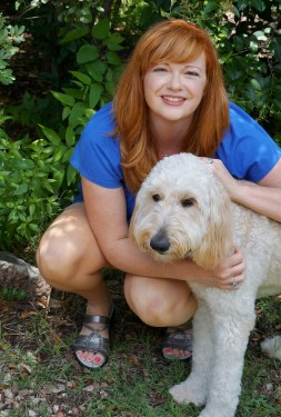 Christine the Psychic and her goldendoodle, Trixie.