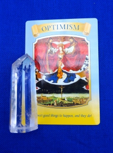 Optimism card on blue background.